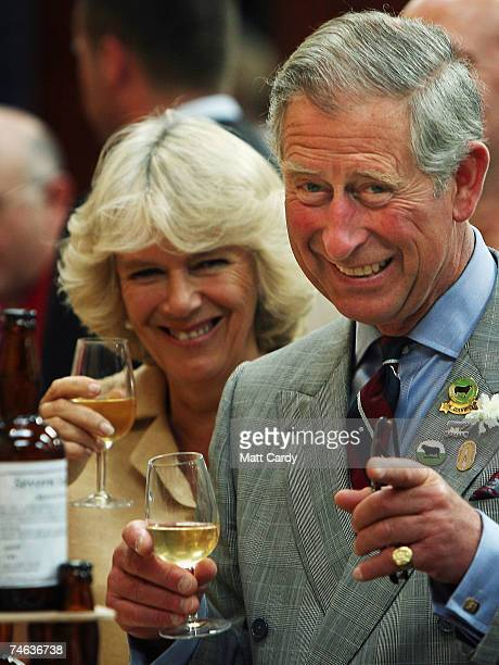 Prince Charles Prince of Wales and the Camilla Duchess of Cornwall laugh as they enjoy a drink at the the Three Counties Showground near Malvern on...