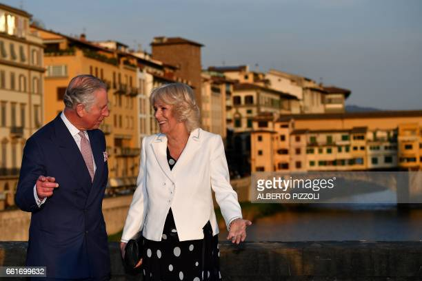 Prince Charles Prince of Wales and the Duchess of Cornwall Camilla pose with the Ponte Vecchio in the background as they arrive in Florence on March...