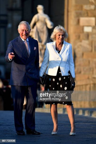 Prince Charles Prince of Wales and the Duchess of Cornwall Camilla walk in Florence on March 31 2017 as part of a sixday visit in Italy and Vatican...