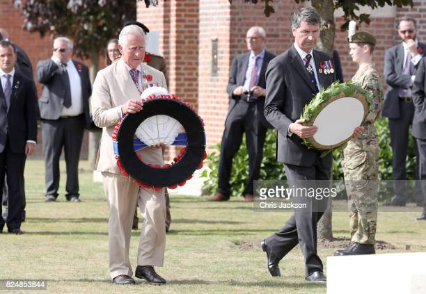 Prince Charles Prince of Wales and Vice Admiral Sir Timothy Laurence lay wreaths during a visit to Artillery Wood Cemetery which includes the graves...