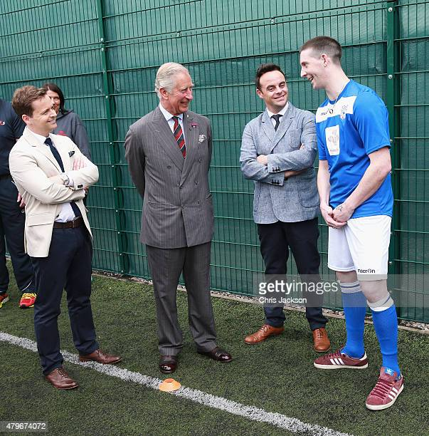 Prince Charles Prince of Wales Anthony McPartlin and Declan Donnelly chat to inmate Thomas Lloyd who is taking part in a 'Get Started with Football'...