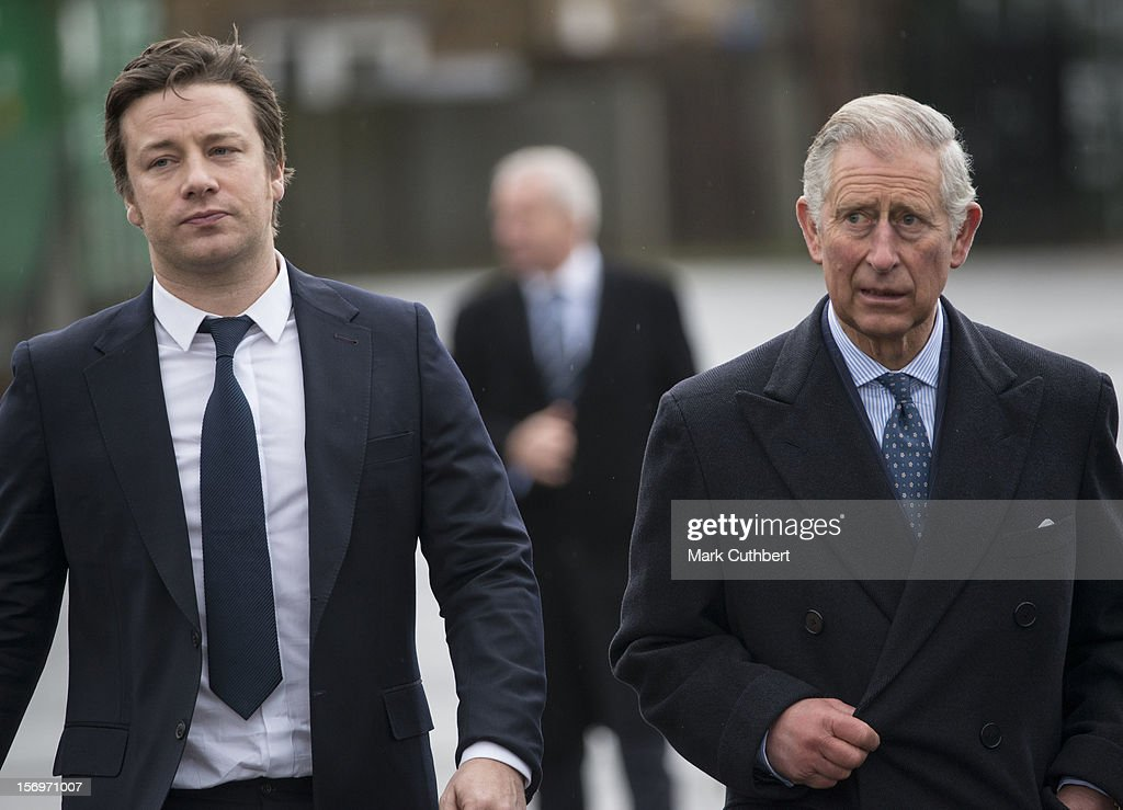 Prince Charles, Prince of Wales arrives with <a gi-track='captionPersonalityLinkClicked' href=/galleries/search?phrase=Jamie+Oliver&family=editorial&specificpeople=159384 ng-click='$event.stopPropagation()'>Jamie Oliver</a> at Carshalton Boys Sports college to see how the school has transformed its approach to healthy eating on November 26, 2012 in Carshalton, England.