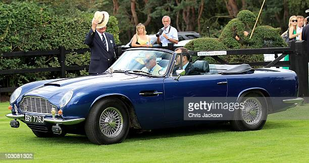 Prince Charles Prince of Wales arrves in his Aston Martin at Guards Polo Club for the Cartier International Polo Day on July 25 2010 in Egham England