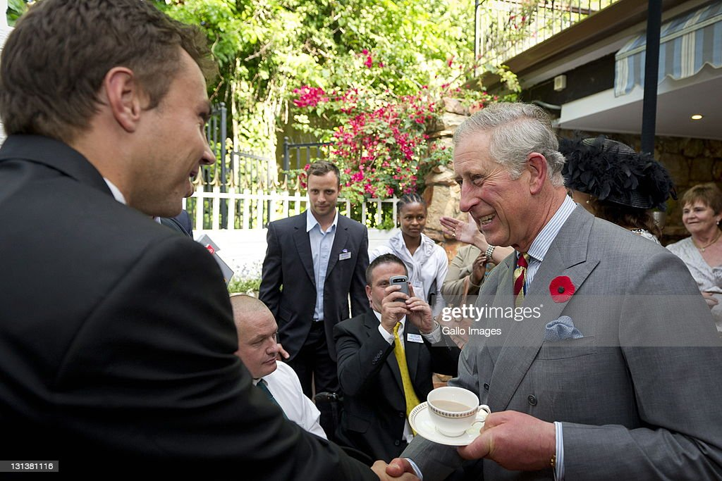 <a gi-track='captionPersonalityLinkClicked' href=/galleries/search?phrase=Prince+Charles+-+Prince+of+Wales&family=editorial&specificpeople=160180 ng-click='$event.stopPropagation()'>Prince Charles</a>, Prince of Wales (R) at the Trade Commissioners Residence on November 3, 2011 in Johannesburg, South Africa. The Prince and his wife the Duchess of Cornwall are visiting South Africa as part of the Commonwealth tour.