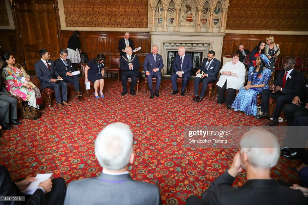 Prince Charles, Prince of Wales attend a roundtable discussion with community leaders and young people, Manchester Town Hall, about the impact of the recent terror attack. June 26, 2017 in Manchester, England. Earlier in the day the Prince of Wales and the Duchess visited the scene of the suicide attack at the Manchester Arena. During their visit they both wore a Worker Bee badge, the symbol of the City of Manchester, which has now taken on more credence by people as a sign of resilience.