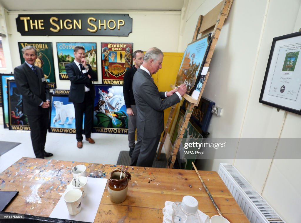 prince-charles-prince-of-wales-autographs-a-plaque-during-a-tour-of-picture-id654470994