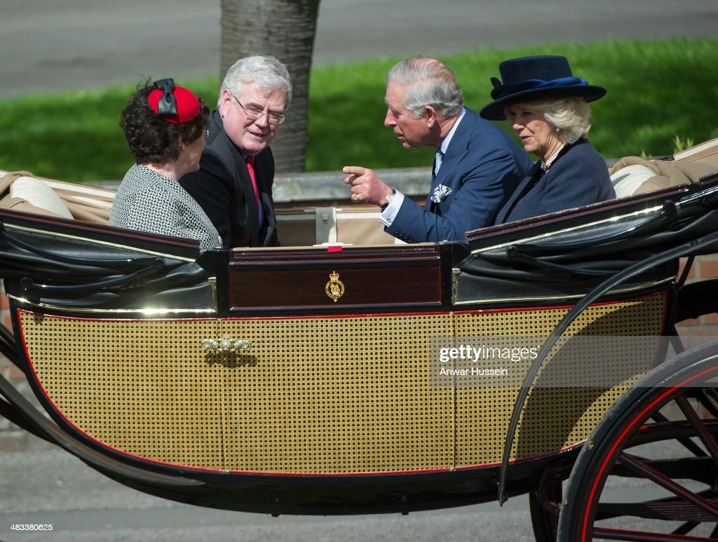 <a gi-track='captionPersonalityLinkClicked' href=/galleries/search?phrase=Prince+Charles+-+Prince+of+Wales&family=editorial&specificpeople=160180 ng-click='$event.stopPropagation()'>Prince Charles</a> Prince of Wales, <a gi-track='captionPersonalityLinkClicked' href=/galleries/search?phrase=Camilla+-+Duchess+of+Cornwall&family=editorial&specificpeople=158157 ng-click='$event.stopPropagation()'>Camilla</a>, Duchess of Cornwall and Irish Foreign Minister <a gi-track='captionPersonalityLinkClicked' href=/galleries/search?phrase=Eamon+Gilmore&family=editorial&specificpeople=7484923 ng-click='$event.stopPropagation()'>Eamon Gilmore</a> leave the ceremonial welcome for the Irish President in an open carriage on April 08, 2014 in Windsor, England.