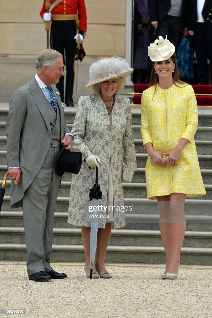 Prince Charles, Prince of Wales, <a gi-track='captionPersonalityLinkClicked' href=/galleries/search?phrase=Camilla+-+Duquesa+da+Cornualha&family=editorial&specificpeople=158157 ng-click='$event.stopPropagation()'>Camilla</a>, Duchess of Cornwall and <a gi-track='captionPersonalityLinkClicked' href=/galleries/search?phrase=Catherine+-+Duquesa+de+Cambridge&family=editorial&specificpeople=542588 ng-click='$event.stopPropagation()'>Catherine</a>, Duchess of Cambridge attend a Garden Party in the grounds of Buckingham Palace hosted by Queen Elizabeth II on May 22, 2013.