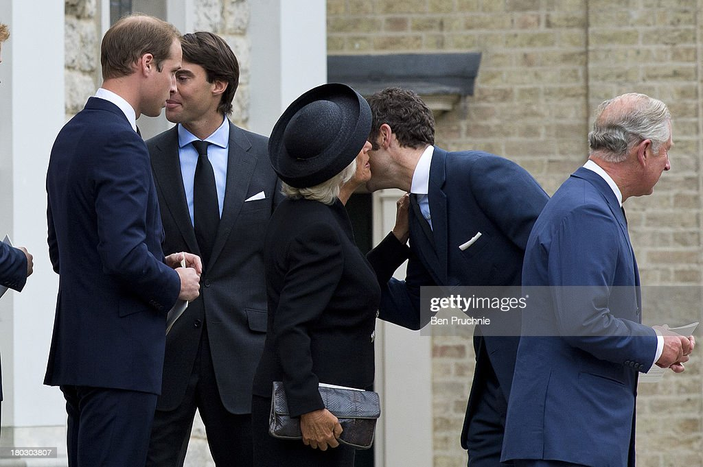 Prince Charles, Prince of Wales (R), Camilla Duchess of Cornwall (3rd R) and Prince William, Duke of Cambridge (L) are greeted by Hugh van Cutsem Jr (2nd R) and William van Cutsem while attending a requiem mass for Hugh van Cutsem who passed away on September 2nd 2013 at Brentwood Cathedral on September 11, 2013 in Brentwood, England.