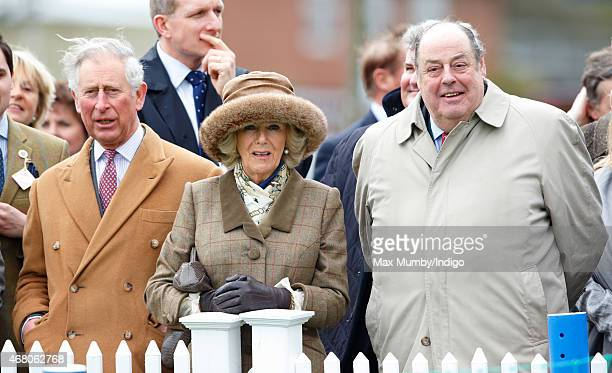 Prince Charles Prince of Wales Camilla Duchess of Cornwall and Sir Nicholas Soames watch the 'Campaign for Wool Lamb National' sheep race as they...