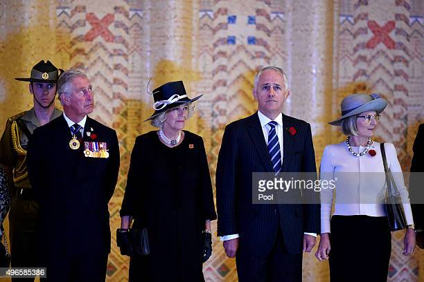 Prince Charles Prince of Wales Camilla Duchess of Cornwall Australian Prime Minister Malcolm Turnbull and his wife Lucy pause after laying a floral...