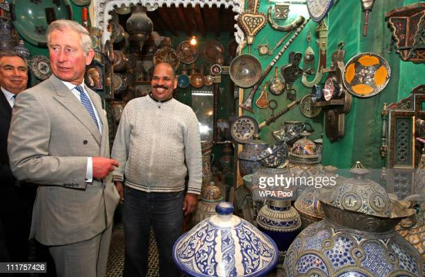 Prince Charles Prince of Wales chats to a local trader during a tour of the old city on April 6 2011 in Fez Morocco Prince Charles Prince of Wales...