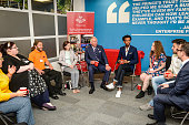 Prince Charles Prince of Wales chats with young people in a group discussion who have been helped by The Prince's Trust during a visit to his his...