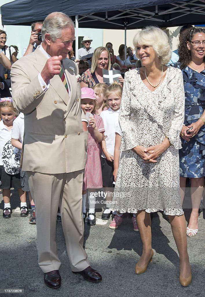 Prince Charles, Prince of Wales cheers as <a gi-track='captionPersonalityLinkClicked' href=/galleries/search?phrase=Camilla+-+Hertiginna+av+Cornwall&family=editorial&specificpeople=158157 ng-click='$event.stopPropagation()'>Camilla</a>, Duchess of Cornwall, is played Happy Birthday on her 66th birthday, during a walkabout on a visit to Lostwithiel on July 17, 2013 in Cornwall, England.