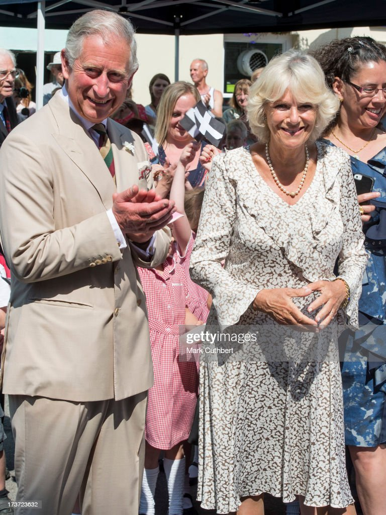 Prince Charles, Prince of Wales cheers as Camilla, Duchess of Cornwall, is played Happy Birthday on her 66th birthday, during a walkabout on a visit to Lostwithiel on July 17, 2013 in Cornwall, England.