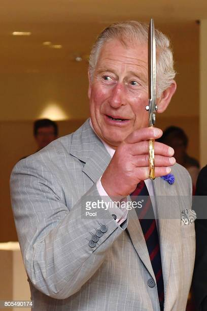 Prince Charles Prince of Wales cuts a ribbon to offiicially reopen the National Arts Centre during a 3 day official visit to Canada on July 1 2017 in...