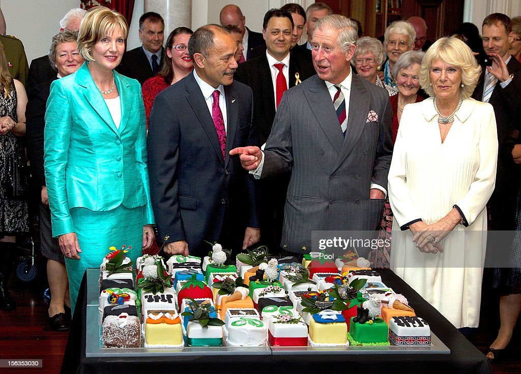 Prince Charles, Prince of Wales (2nd R) cuts his 64th birthday cake with Governor-General of New Zealand Sir Jerry Mateparae (2nd L) at Government House on November 14, 2012 in Wellington, New Zealand. The Royal couple are in New Zealand on the last leg of a Diamond Jubilee that takes in Papua New Guinea, Australia and New Zealand.
