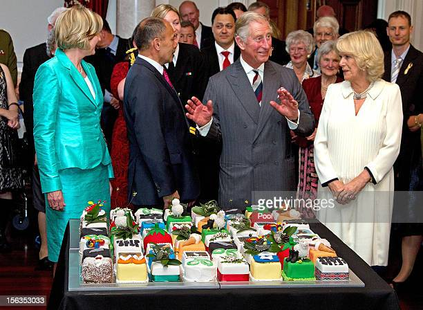 Prince Charles Prince of Wales cuts his 64th birthday cake with GovernorGeneral of New Zealand Sir Jerry Mateparae at Government House on November 14...