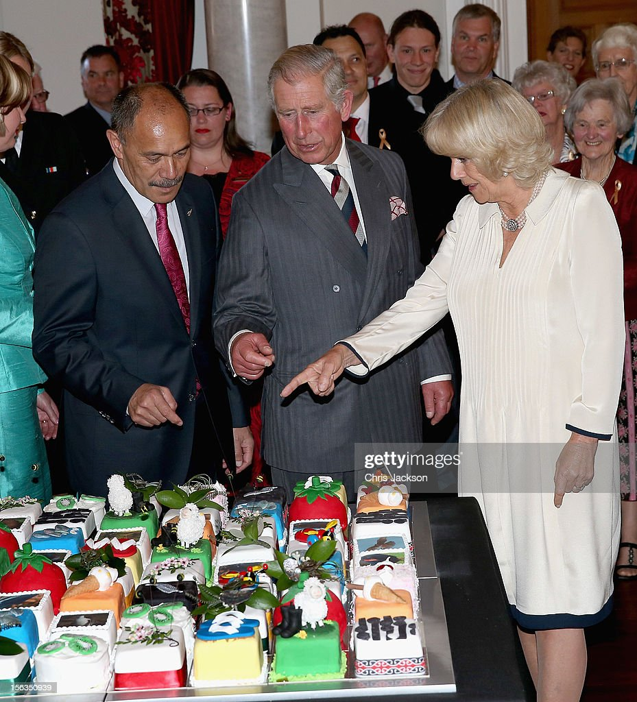 Prince Charles, Prince of Wales cuts his 64th birthday cake with Sir Jerry Mateparae Governor-General of New Zealand at Government House on November 14, 2012 in Wellington, New Zealand. The Royal couple are in New Zealand on the last leg of a Diamond Jubilee that takes in Papua New Guinea, Australia and New Zealand.