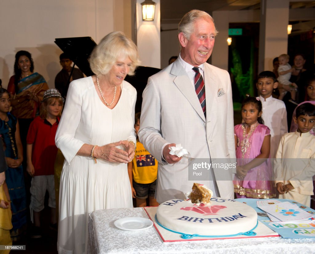 <a gi-track='captionPersonalityLinkClicked' href=/galleries/search?phrase=Prince+Charles&family=editorial&specificpeople=160180 ng-click='$event.stopPropagation()'>Prince Charles</a>, Prince of Wales cuts his 65th Birthday cake as <a gi-track='captionPersonalityLinkClicked' href=/galleries/search?phrase=Camilla+-+Duchess+of+Cornwall&family=editorial&specificpeople=158157 ng-click='$event.stopPropagation()'>Camilla</a>, Duchess of Cornwall looks on during a reception at the British High Commission on November 14, 2013 in Colombo, Sri Lanka. The Royal couple are visiting Sri Lanka in order to attend the 2013 Commonwealth Heads of Government Meeting.