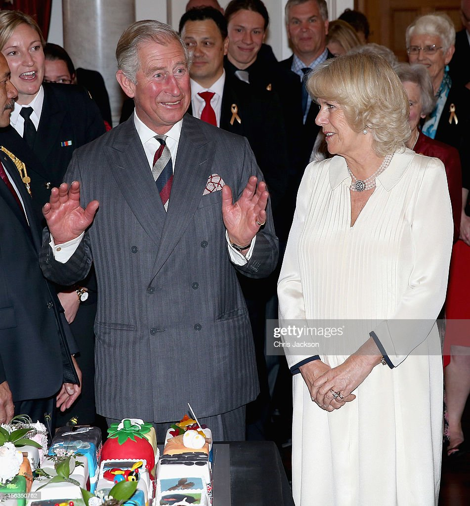 <a gi-track='captionPersonalityLinkClicked' href=/galleries/search?phrase=Prince+Charles&family=editorial&specificpeople=160180 ng-click='$event.stopPropagation()'>Prince Charles</a>, Prince of Wales dances as he is presented with his 64th birthday cake at Government House on November 14, 2012 in Wellington, New Zealand. The Royal couple are in New Zealand on the last leg of a Diamond Jubilee that takes in Papua New Guinea, Australia and New Zealand.