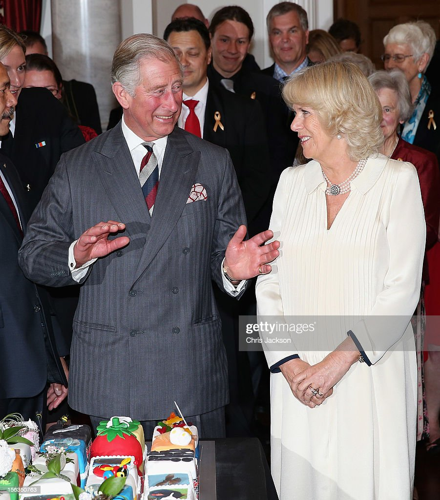 Prince Charles, Prince of Wales dances as he is presented with his 64th birthday cake at Government House on November 14, 2012 in Wellington, New Zealand. The Royal couple are in New Zealand on the last leg of a Diamond Jubilee that takes in Papua New Guinea, Australia and New Zealand.