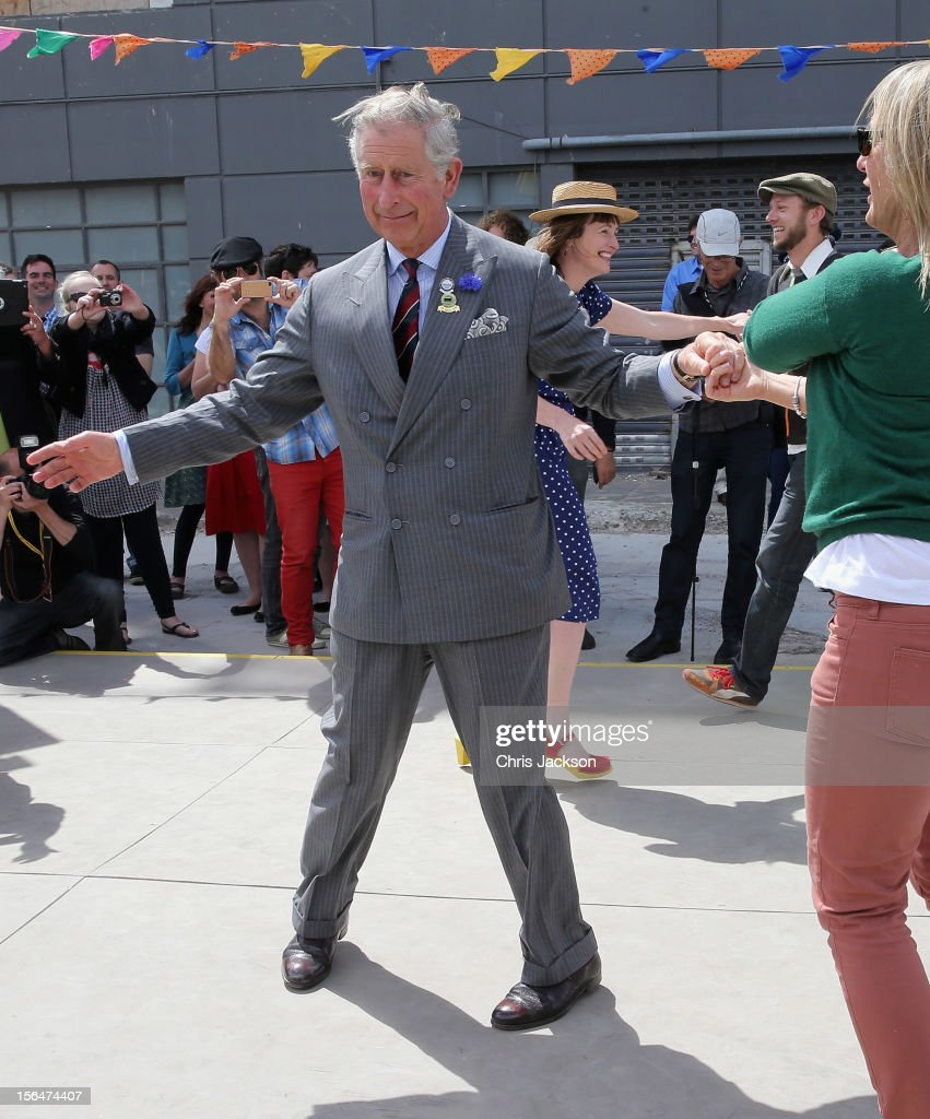 Prince Charles, Prince of Wales dances with Lisa Shannon at the Dance-O-Mat during a visit to Christchurch on November 16, 2012 in Christchurch, New Zealand. The Dance-O-Mat was set up to give people the opportunity to keep dancing after many of the venues were destroyed by the earthquake of 2010. The Royal couple are in New Zealand on the last leg of a Diamond Jubilee that takes in Papua New Guinea, Australia and New Zealand.