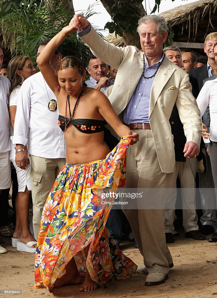 Prince Charles, Prince of Wales dances with twenty year old Nayara in the remote Maguari village durinjg a tour of the Amazon rainforerst on March 14, 2009 in Manaus, Brazil. The Prince and the Duchess are in Brazil as part of a ten day tour of South America taking in Chile, Brazil, Ecuador and the Galapagos.
