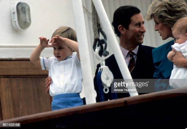 Prince Charles Prince of Wales Diana Princess of Wales and their children Prince William and Prince Harry look out from the deck of the Royal Yacht...