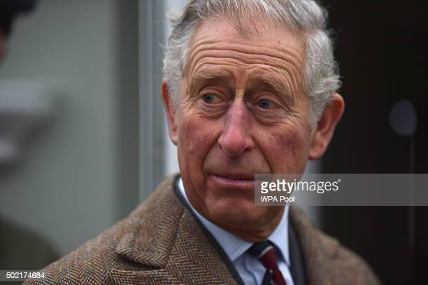 Prince Charles Prince of Wales during a visit to victims of the flooding caused by Storm Desmond in Warwick Road on December 21 in Carlisle United...