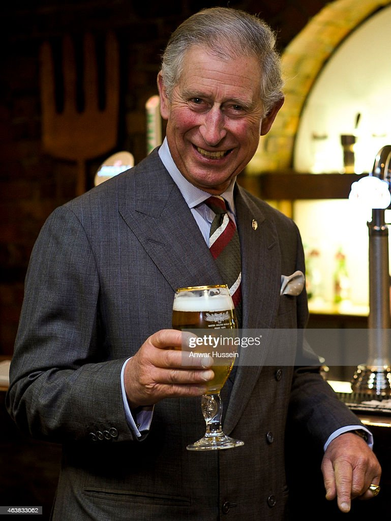 Prince Charles, Prince of Wales enjoys a glass of beer during a visit to the InBev Brewery on November 21, 2011 in Caldicot, Wales.