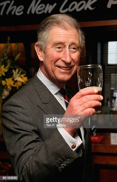 Prince Charles Prince of Wales enjoys a pint of beer while he meets local people at The Viaduct Pub during his visit to Froncysyllte winner of the...