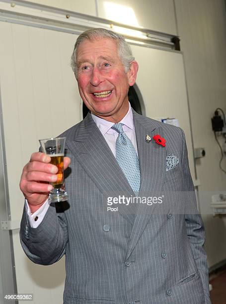 Prince Charles Prince of Wales enjoys taste testing local beer at West Coast Brewery on November 7 2015 in Westport New Zealand The Royal couple are...