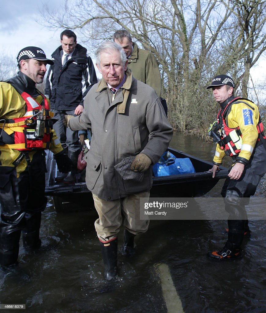 Prince Charles Prince of Wales gets off a humanitarian support boat as he visits the flood hit village of Muchelney to meet residents affected by...