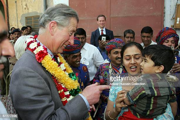 Prince Charles Prince of Wales greets a child as he takes a walking tour of the Old City on the final day of a 12 day official tour visiting Egypt...
