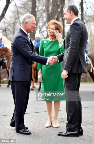 Prince Charles Prince of Wales greets Crown Princess Margareta of Bucharest and Prince Radu of Bucharest during a Tea with the Romanian Royal Family...