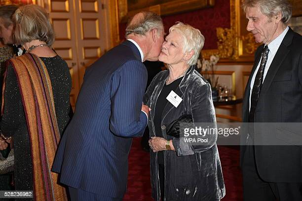 Prince Charles Prince of Wales greets Dame Judi Dench during a reception at St James's Palace for British Oscar winners on May 4 2016 in London...