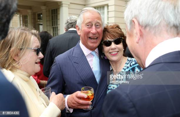 Prince Charles Prince of Wales greets Kathy Lette at a reception to mark The Duchess of Cornwall's 70th birthday at Clarence House on July 13 2017 in...