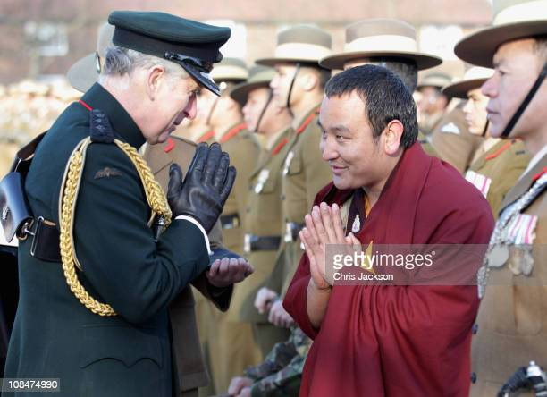 Prince Charles Prince of Wales greets Lama Chawan Gurung as he presents Afghanistan Service Medals to Gurkas at Sir John Moore Barracks on January 28...