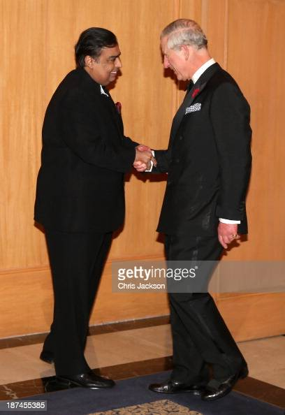 Prince Charles Prince of Wales greets Mukesh Ambani at the British Asian Trust Reception on day 4 of an official visit to India on November 9 2013 in...