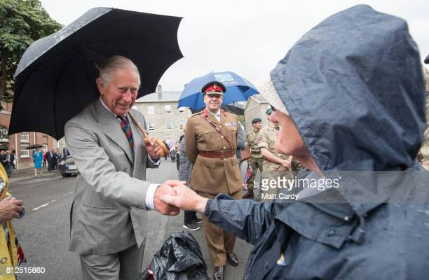 Prince Charles Prince of Wales greets people as visits the Royal Welsh Regimental Museum during The Prince of Wales' annual Summer visit to Wales on...