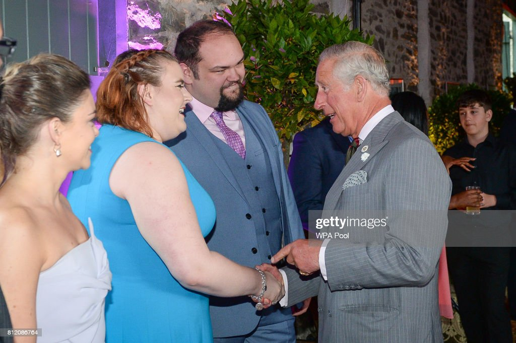 Prince Charles, Prince of Wales greets performer Becca Barrett at the barn at his Welsh home near Llandovery, where he is hosting a music and drama evening, also featuring performances by students of the Royal Welsh College of Music and Drama on July 10, 2017 in Ceredigion, Wales.