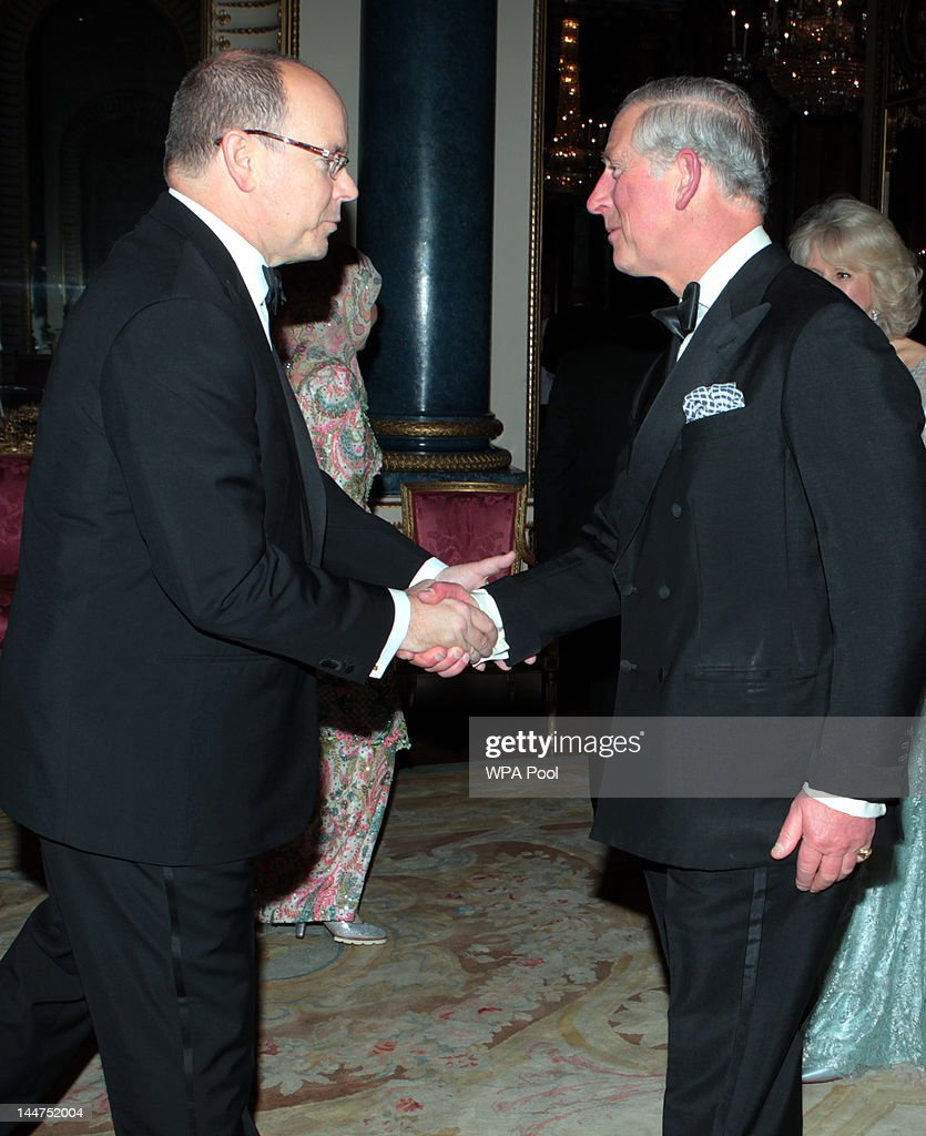Prince Charles, Prince of Wales greets Prince Albert II of Monaco as he arrives for a dinner for foreign Sovereigns to commemorate the Diamond Jubilee at Buckingham Palace on May 18, 2012 in London, England. Prince Charles, Prince of Wales and Camilla, Duchess of Cornwall hosted the event.