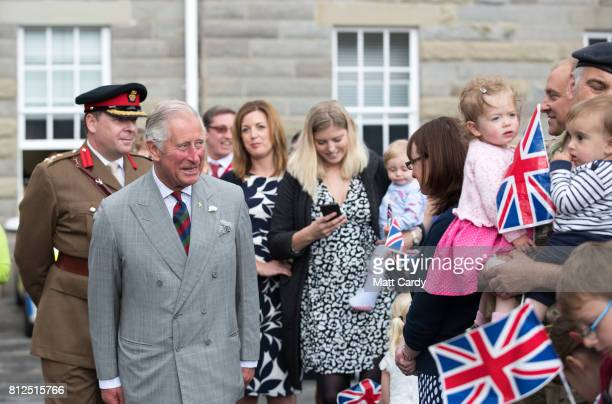 Prince Charles Prince of Wales greets the families of service people as he visits the Royal Welsh Regimental Museum during The Prince of Wales'...