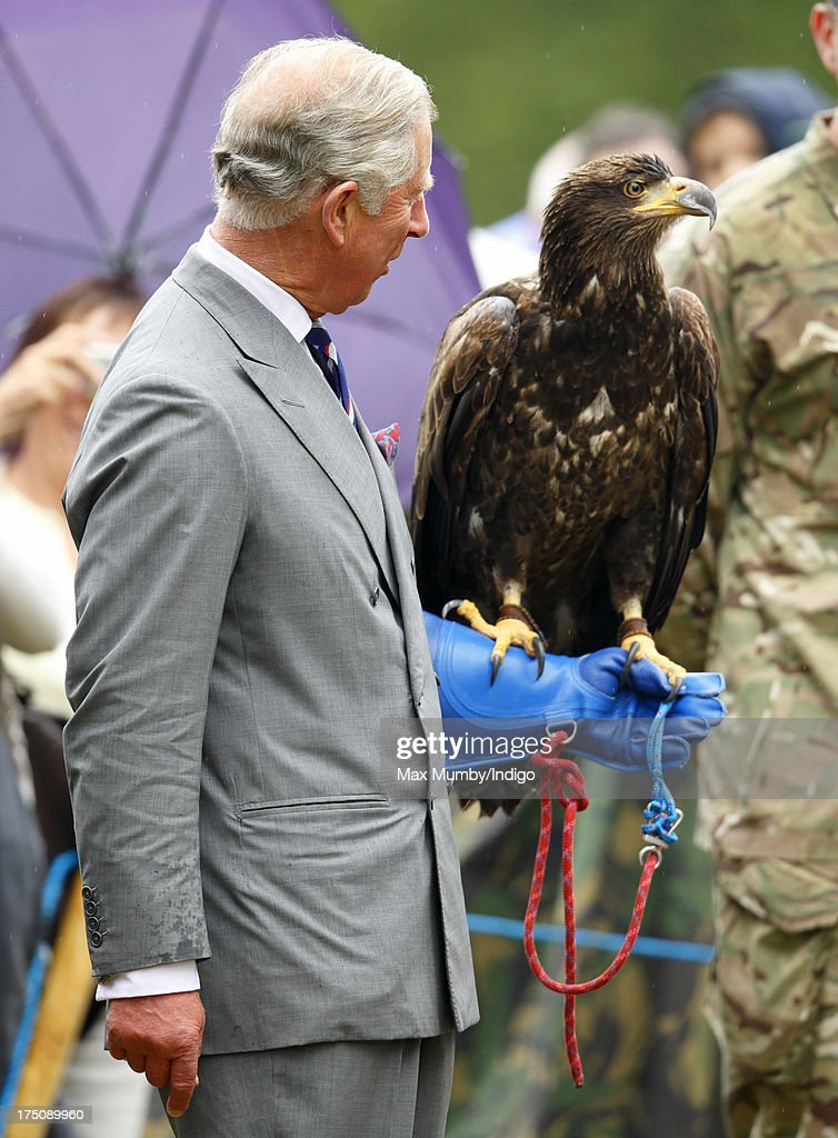 Prince Charles, Prince of Wales holds a Bald Eagle called Zephyr as he and Camilla, Duchess of Cornwall visit the 132nd Sandringham Flower Show at Sandringham House on July 31, 2013 in King's Lynn, England.