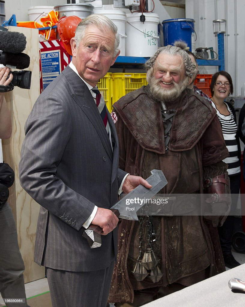 Prince Charles, Prince of Wales holds a sword after meeting Mark Hadlow who plays Dori in the new 'Hobbit' film at Weta Workshop on November 14, 2012 in Wellington, New Zealand. The Royal couple are in New Zealand on the last leg of a Diamond Jubilee that takes in Papua New Guinea, Australia and New Zealand.