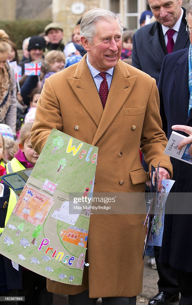 <a gi-track='captionPersonalityLinkClicked' href=/galleries/search?phrase=Prince+Charles&family=editorial&specificpeople=160180 ng-click='$event.stopPropagation()'>Prince Charles</a>, Prince of Wales holds pictures and paintings given to him by local schoolchildren whilst visiting the Uley Community Stores and Post Office on February 22, 2013 in Uley, Gloucestershire, England.
