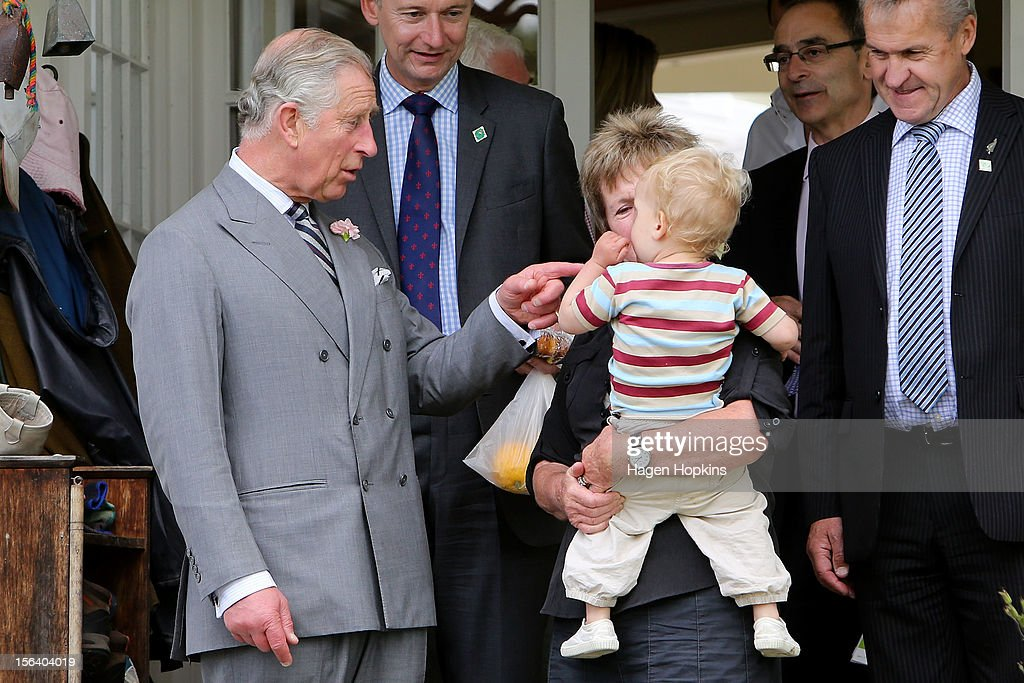 <a gi-track='captionPersonalityLinkClicked' href=/galleries/search?phrase=Prince+Charles&family=editorial&specificpeople=160180 ng-click='$event.stopPropagation()'>Prince Charles</a>, Prince of Wales interacts with members of the Dermer family at Waipiko Farm on November 15, 2012 in Feilding, New Zealand. The Royal couple are in New Zealand on the last leg of a Diamond Jubilee that takes in Papua New Guinea, Australia and New Zealand.