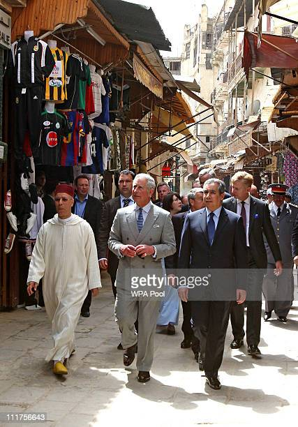 Prince Charles Prince of Wales is given a tour of the old city by Minister of Waqf and Islamic affairs Ahmed Tawfiq on April 6 2011 in Fez Morocco...