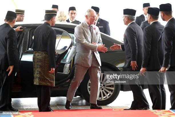 Prince Charles Prince of Wales is greeted as he arrives with Camilla Duchess of Cornwall for Tea with His Majesty The Yang diPertuan Agong XV Sultan...